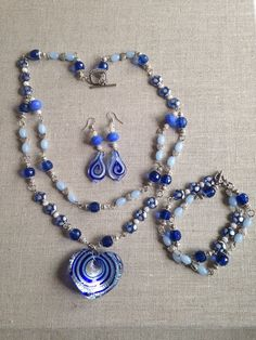 Items similar to Shades of Blue Glass Heart Necklace, Bracelet, and Earrings Jewelry Set Great Gift! on Etsy Shades Of Blue, Great Gifts, My Etsy Shop, Beaded Necklace, Heart, Unique Jewelry, Bracelets, Handmade Gifts, Glass