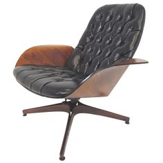 1stdibs.com | Mid-Century Swivel High Back Lounge Chair by George Mulhauser for Plycraft