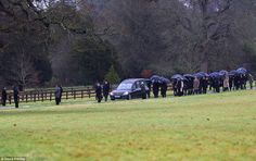 Mourners line the route as the cortège makes its way through the grounds of Stratfield Saye House to the nearby church this morning