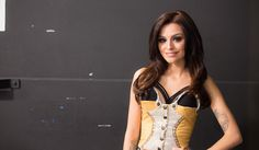 Cher Lloyd poses after her performance.