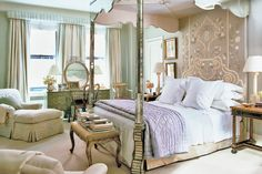 """Bunny Williams' bedroom: Mismatched bedside tables make for a less """"decorator-y"""" look; tall lamps cast light at just the right height for reading in bed. """"I love bright modern prints, but tend to use them sparingly since you tire of them. I do neutral—never white-on-white—rooms.""""  Ms. Williams upholstered the headboard in an Indian-inspired silsilk embroidery by Naeem Khan. """"I like fabrics to look natural, whether a cotton or a silk or a good imitation""""—a bias rooted in her Parish-Hadley days."""