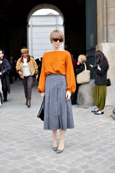 Midi skirts.  Uggh.  Cut a girl off 5 inches from the floor, and even the glam models look frumpy and over-weight.  The scale is tipped too bottom-heavy, and the eye drags down.  This would feel so much lighter and fresher if this skirt were hemmed at the knee.