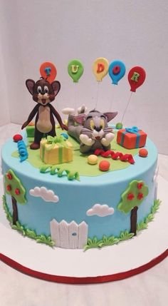 Tudor wanted Tom & Jerry cake theme, so I made these characters for the first time for him :) and I was happy about the result :) What do you think? Bolo Tom E Jerry, Tom And Jerry Cake, Tom Y Jerry, Second Birthday Ideas, 2nd Birthday, Tom And Jeery, Tom And Jerry Kids, Fondant Lace, Royal Icing Cakes