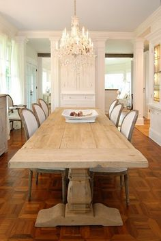 Love the contrast of a rustic looking natural table with the delicate chandelier