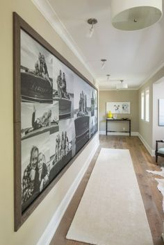 I stumbled upon this photo and the collage of pictures immediately caught my eye.  Long hallways can be tough to decide how to display photos and I loved the black and white photos with the wood frame nailed into the wall around it.  This custom mural was done by Murals Your Way.  You can order pre-
