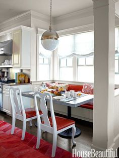Inspired by French cafés, designer Stephen Shubel designed zinc-top tables for the breakfast room.