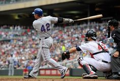 MINNEAPOLIS, MN - APRIL 15: Josh Hamilton of the Texas Rangers hits a two run home run as Joe Mauer of the Minnesota Twins defends home plate during the eighth inning on April 15, 2012 at Target Field in Minneapolis, Minnesota. The Rangers defeated the Twins 4-3. Minnesota Twins and the Texas Rangers wore the number 42 to honor Jackie Robinson. (Photo by Hannah Foslien/Getty Images) game 10