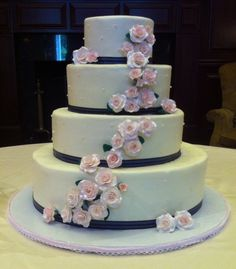 #WeddingCake I made for a friend. It's alternating white and strawberry cake tiers, iced with cream cheese buttercream, and decorated with #GumPaste roses. #CakeDecorating