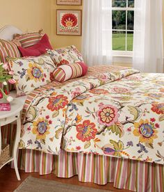 This quilt from Country Curtains has the Pottery Barn meets Horchow feel. Pretty for summer
