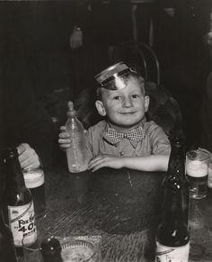3 year old boy in a night club at 5 in the morning on New Year's day, New York, 1943