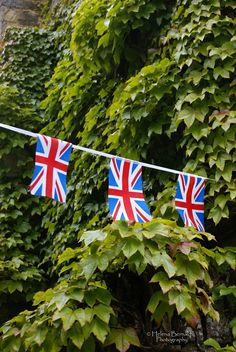 Union Jack bunting at the church, near Rose cottages and gardens, Britain