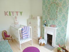 vintage girls bedroom=love the wallpaper around the fireplace