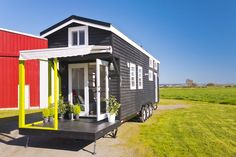 A custom tiny house by the Mint Tiny House Company (formerlyTiny Living Homes). A 310 sq ft tiny home on wheels with two lofts.