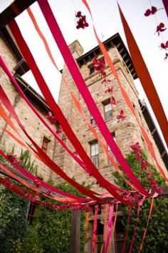 Fabric ribbons strung up everywhere.  Flows in the wind...beautiful idea in the garden during the warm Summer months.