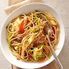 We love the bright flavor that lime and chile-garlic sauce give to this quick and easy veggie-and-noodle stir-fry. Multicolored peppers make this recipe festive, while the addition of eggs makes it a satisfying vegetarian supper.