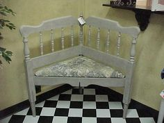 corner bench made out of an old bed