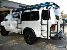 Aluminum Off Road Rear Bumper and Ladders on a Ford Econoline van.