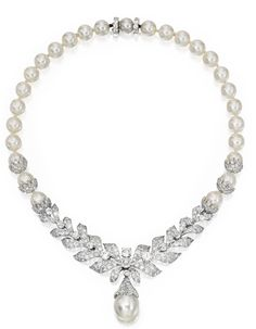 CULTURED PEARL, PLATINUM AND DIAMOND NECKLACE, CIRCA 1940.  The necklace composed of 27 cultured pearls measuring approximately 8.8 to 9.8 mm,the front accented with a foliate motif andthe claspset with round, old European and single cut diamondsweighing approximately 21.55 carats, suspending a baroque cultured pearl drop measuring approximately 12.8 by13.9 mm, length 16 inches.
