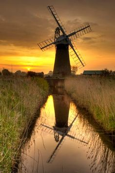 England Travel Inspiration - Norfolk-St Benet's Mill was a level drainage mill and stood on Horning marshes on the opposite side of the River Thurne to the white Thurne drainage mill. The mill was originallly built around 1775 with common sails. Norfolk Broads, Norfolk England, Dom Quixote, Water Tower, Le Moulin, Terra, Countryside, Sunrise, Beautiful Places