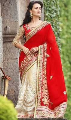 Look simply stunning in this red and beige color raw silk lehenga sari. This pretty attire is displaying some amazing embroidery done with lace work. Upon request we can make round front/back neck and short 6 inches sleeves regular saree blouse also. #TrendyClassicalDesignOfLehengaSari