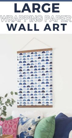How to make large scale wall art for cheap using wrapping paper and scrap wood.