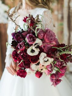 Deep pink wedding bouquet with roses, tulips and Anemones | We Are Origami Photography | See more: http://theweddingplaybook.com/elegant-industrial-wedding-inspiration/