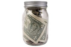 Put $1 in the jar every time you work out. Set a goal for yourself (say $100) then use that to treat yourself with a new outfit or a massage :)