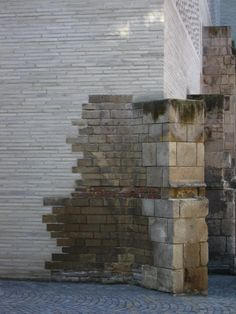"Kolumba Kunstmuseum, Cologne, Germany, 1996 | Zumthor, consistently mindful of the use of the materials, and specifically their construction details, has used grey brick to unite the destroyed fragments of the site. These fragments include the remaining pieces of the Gothic church, stone ruins from the Roman and medieval periods, and German architect Gottfried Böhm's 1950 chapel for the ""Madonna of the Ruins."""