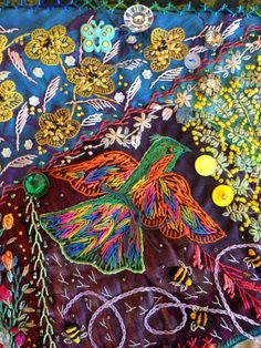 Rainbow Bird on crazy quilt by Robyn Ginn