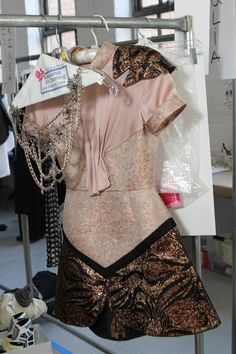 Rodarte SS13 dress with Swarovski Elements Crystals hanging backstage before the show
