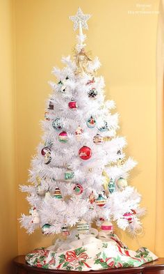 A white Christmas tree with vintage Shiny Brite ornaments creates a modern retro holiday look that fits in with any home decor style for the holiday season!