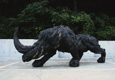 Rhino sculpture from old tires, by Yong Ho Ji.