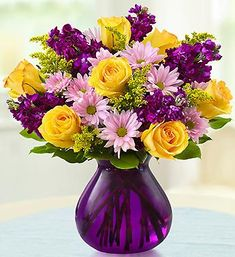 This chic Floral Devotion Bouquet  featuring sunshine yellow roses, purple stock and cheerful pink daisies will certainly grab that special someone's attention.
