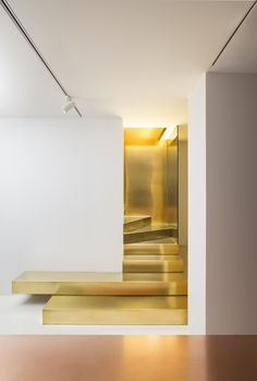 Gold Staircase // Meditation through consumerism, water filtration through art, terrazzo in the form of a rug, and the prettiest damn staircase you've ever seen.