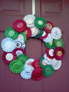 Holiday Wreath made of dog show rosettes. Christmas decor. Dog obedience, agility, conformation ribbons.