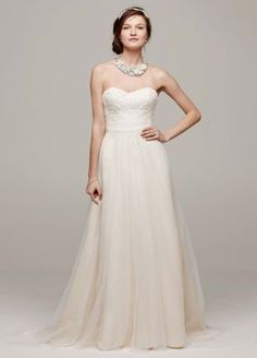 Ethereal elegance meets modern day fairy tale in this enchanting strapless tulle wedding dress!  Strapless A line gown features stunning beaded lace detail on bodice.  Softtulle skirt adds movement and is absolutely breath-taking.  Sizes 0-14. Sweep train.  Ivory/Champagne available in stores and online. Solid Ivory and Solid White available for Special Order in stores.  Woman: Style 9WG3586. Sizes 16W-26W.   Fully lined. Back zip. Imported polyester. Dry clean. To preserve your ...