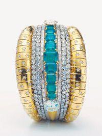 18k yellow gold diamond blue sapphire solitaire ring. Van Cleef & Arpels cuff, originally owned by Ellen Barkin