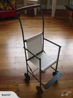 ANTIQUE child's pram-made in NZ  - yes, I had one just like this - maybe the same one?