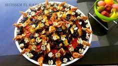 couscous aux fruits de mer ,mérou, moule, clovisse poulet crevette carotte ,petit pois