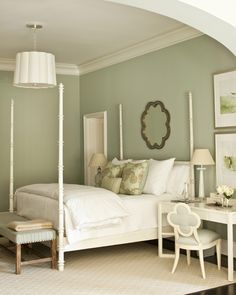 Elegant sage green bedroom design with pale sage green walls paint color and dark hardwood floors.
