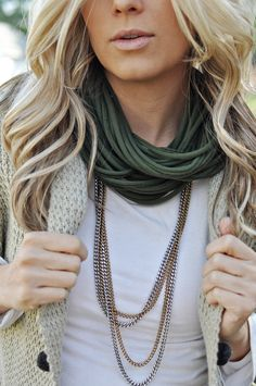 So cute. Is that a ripped up tee-shirt around her neck? So cool!! And love the simple chains.