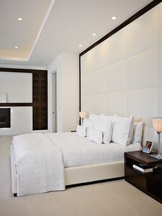 Stylish Padded Wall Panels for Interior Room Design: Awesome White Bed In The Bedroom With White Padded Wall Panels And Wooden Cabinets Under White Ceiling Modern Elegant Bedroom, Contemporary Bedroom, Beautiful Bedrooms, Modern Beds, Small Room Bedroom, Home Bedroom, Bedroom Ideas, Bedroom Designs, Light Bedroom