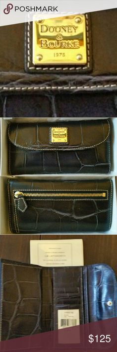 Dooney & Bourke Black Crocodile Wallet/Clutch Dooney & Bourke Black Crocodile embossed wallet/clutch  Keep your cash, cards, checkbook and receipts well organized in this super chic beauty that holds 6 credit cards, has a clear ID window, 2 bill compartments plus 1 under credit cards, an outside zipper pouch and comes with a matching removable croc embossed checkbook cover. Made from embossed black leather and red vinyl; she's designed to hold up to everyday use while looking fab. Comes with…