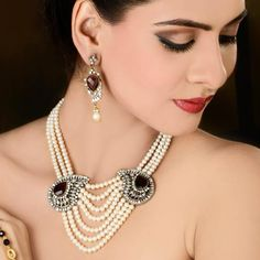 Pearl and diamond designer necklace is a trendy neck piece with two diamond brooches on the side of the neck piece which is attached with the pearls string which you can match with any of your Indo-western outfit. #DesignerDiamondNecklace #IndianImitationJewellery
