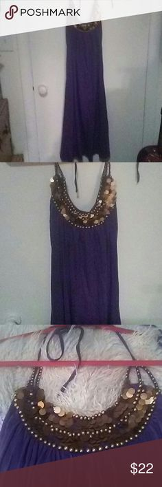 Beautiful sundress This is a beautiful purple Grecian dress almost like that goddess type look beautiful it's a long but it doesn't come down to ankles .past your knees on me anyway and I'm just about five five only wore it once I have too many clothes but I do love it it will definitely make somebody happy gorgeous color and great price. Newport News Dresses Midi