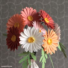 As part of our Midwestern floral bouquet for Cricut, these simple paper daisies are paper flower perfection! Easy-as-can-be!