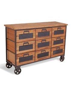 This apothecary chest has 9 drawers each with a space where you can write a name / title with chalk.