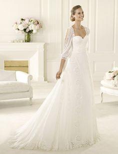 long sleeved wedding dress with flower pattern  @Alison Hobbs Hobbs McCarter