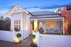 grey weatherboards with white trims