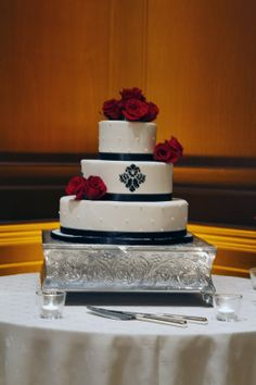 Red, white, & black wedding cake with black ribbon bands and hand-painted detail on center tier | villasiena.cc